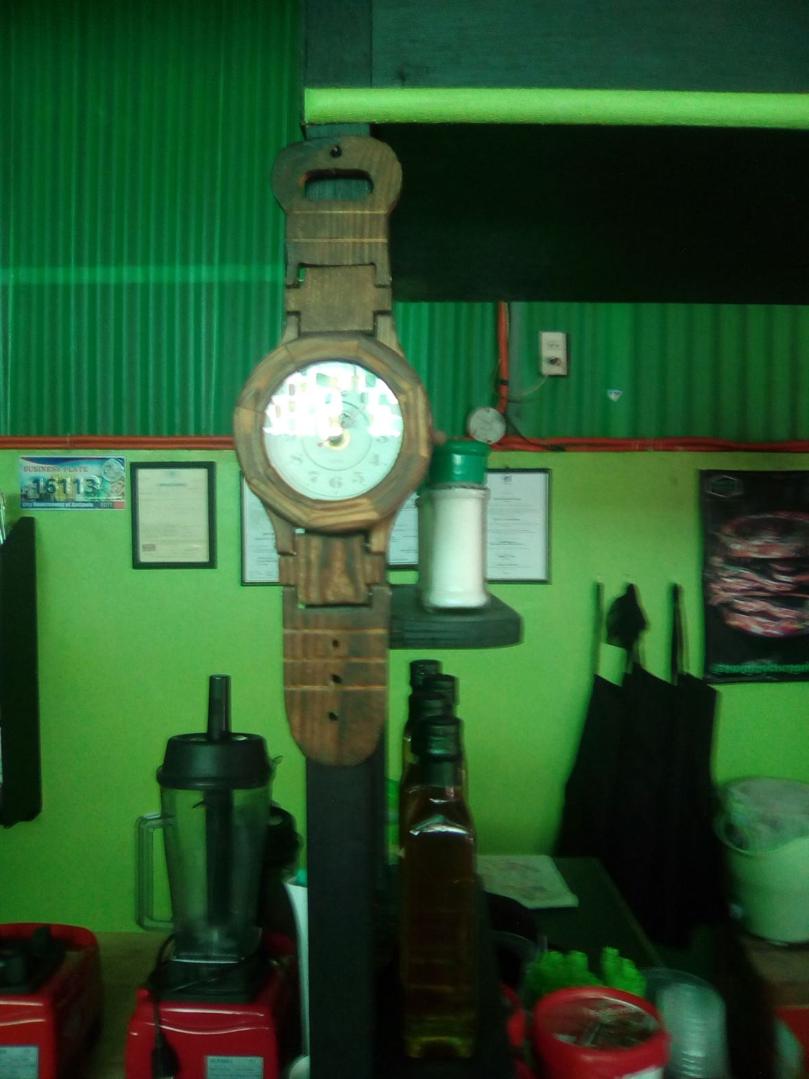 wooden clock at the counter